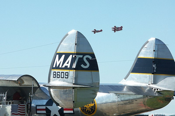 Aerobatics over the tailfins of a MATS plane